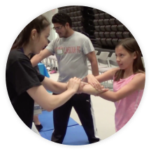 female instructor teaching girl